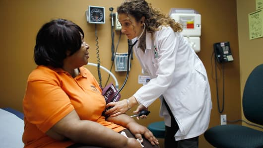 A patient is examined by a doctor in Miami, Florida.