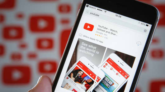 The YouTube video app is seen on various digital devices on 28 March, 2017