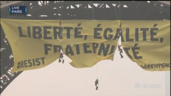 Greenpeace activists deploy anti-FN banner at Eiffel Tower