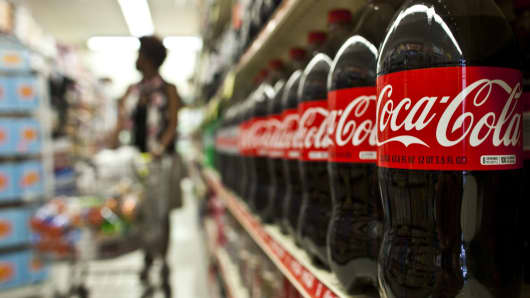 Coca-Cola profits fall as it touts healthier drinks
