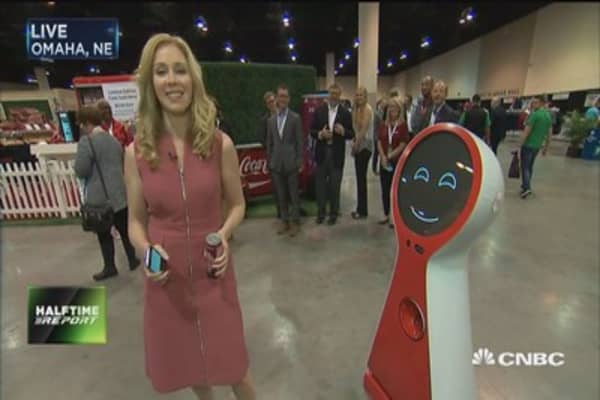 Coca Cola robot greets CNBC's Becky Quick at Berkshire Hathway's annual meeting