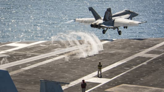 "An F/A-18E Super Hornet from the ""Kestrels"" of Strike Fighter Squadron (VFA) 137 launches from the Nimitz-class aircraft carrier USS Carl Vinson (CVN 70) during flight operations in the western Pacific Ocean."