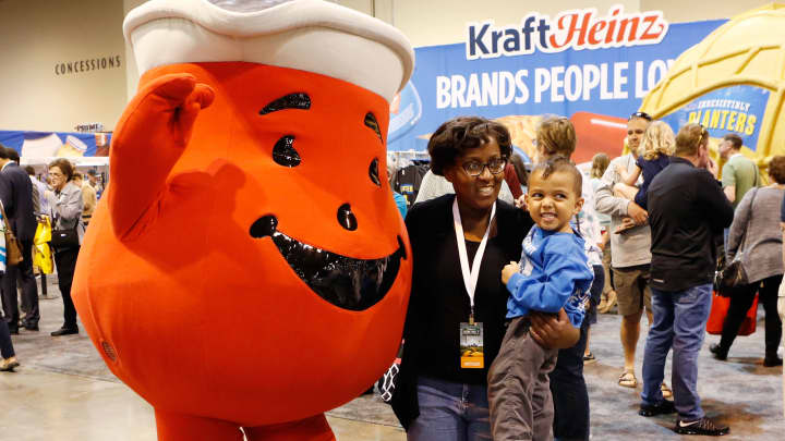 Attendees get a photo with the Kool-Aid Man at the 2017 Berkshire Hathaway Annual Meeting in Omaha, NE.