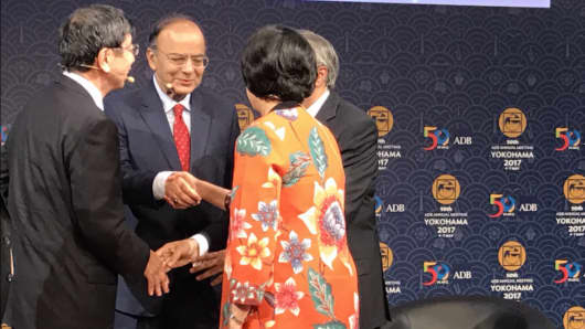 Pakistani Minister for Finance, Revenue, Economic Affairs, Statistics and Privatization Ishaq Dar, Indian Minister of Finance, Defense and Corporate Affairs Arun Jaitley, Indonesian Finance Minister Sri Mulyani Indrawati and Asian Development Bank President Takehiko Nakao share handshakes after a CNBC-hosted debate at the 2017 ADB meeting in Yokohama, Japan.