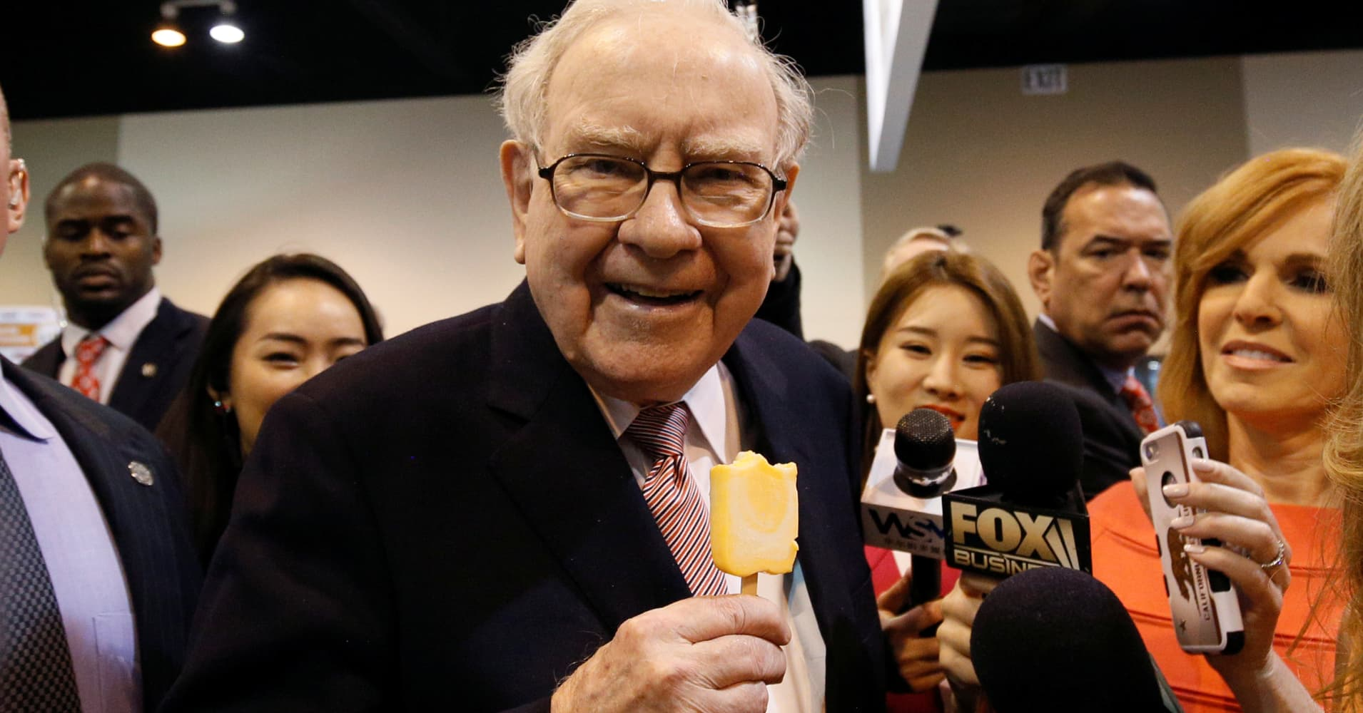 Berkshire Hathaway chairman and CEO Warren Buffett enjoys an ice cream treat from Dairy Queen before the company's annual meeting.