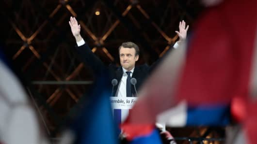 Leader of 'En Marche!' Emmanuel Macron wave to supporters after winning the French Presidential Election, at The Louvre on May 7, 2017 in Paris, France.