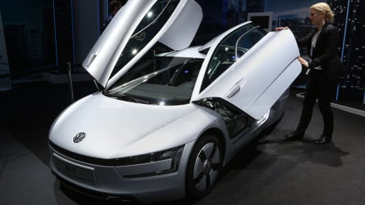 A Volkswagen XL1 plug-in diesel-electric hybrid automobile sits on display at a public Volkswagen event on March 15, 2014, in Berlin, Germany.