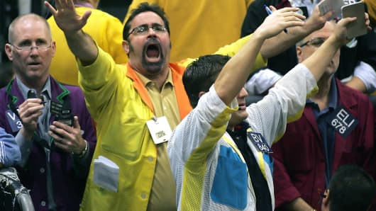 Traders celebrate on the trading floor