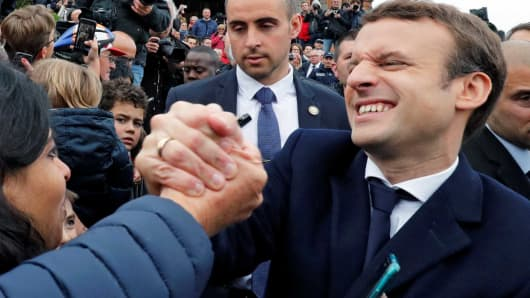 French presidential election candidate Emmanuel Macron, head of the political movement En Marche !, or Onwards ! greets supporters as leaves a polling station during the the second round of 2017 French presidential election, in Le Touquet, France, May 7, 2017.