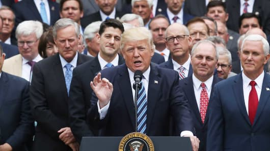 President Donald Trump speaks while flanked by House Republicans after they passed legislation aimed at repealing and replacing Obamacare, during an event in the Rose Garden at the White House, on May 4, 2017 in Washington, DC.