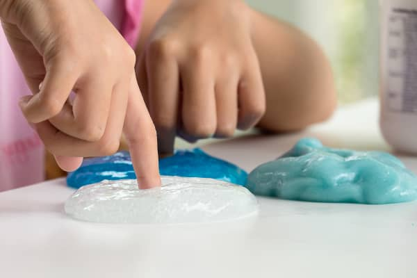 A child playing with slime, the craze boosting glue sales