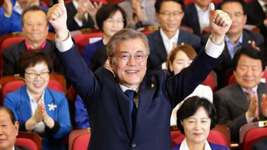 South Korean presidential candidate Moon Jae-in of the Democratic Party of Korea reacts after a television report on an exit poll of the new president at the party's auditorium in the National assembly on May 9, 2017 in Seoul, South Korea.