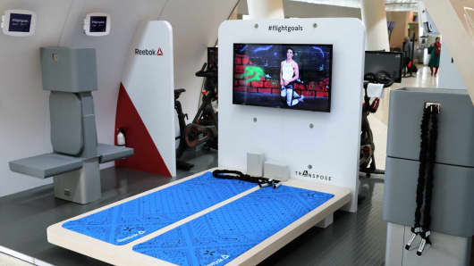 Peloton and Reebok are helping the Transpose team test the airplane workout module at Mineta San Jose International Airport.