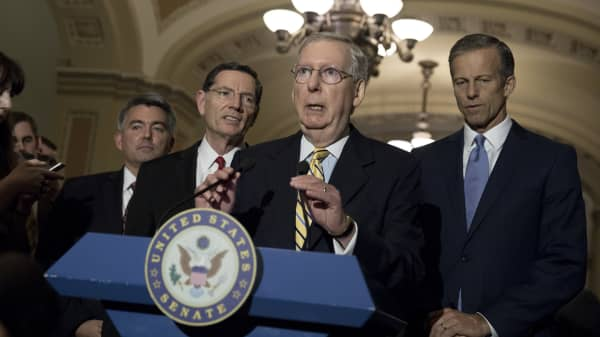 Senate Majority Leader Mitch McConnell, flanked by Sen. Cory Gardner (R-CO), Sen. John Barrasso (R-WY), and Sen. John Thune (R-SD), speaks to the media after the weekly policy luncheon on Capitol Hill May 2, 2017 in Washington, DC.
