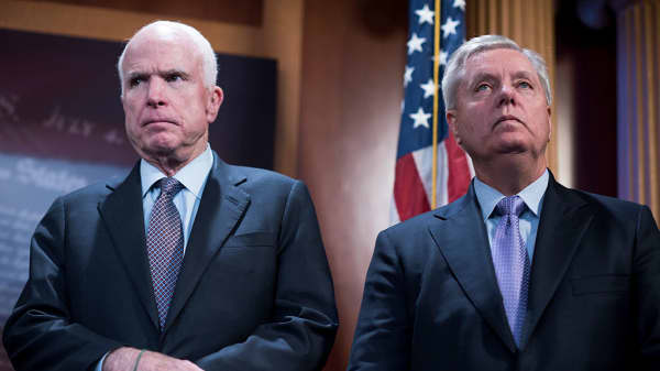 Sens. John McCain, R-Ariz., left, and Lindsey Graham, R-S.C., attend a news conference in the Capitol on January 10, 2017.