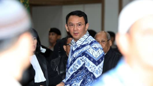 Jakarta's Christian governor Basuki Tjahaja Purnama, popularly known as Ahok, arrives at a courtroom for his verdict and sentence in his blasphemy trial in Jakarta on May 9, 2017.