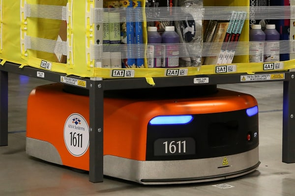 An Amazon Robotics robot moves a rack of merchandise at an Amazon fulfillment center on January 20, 2015 in Tracy, California.