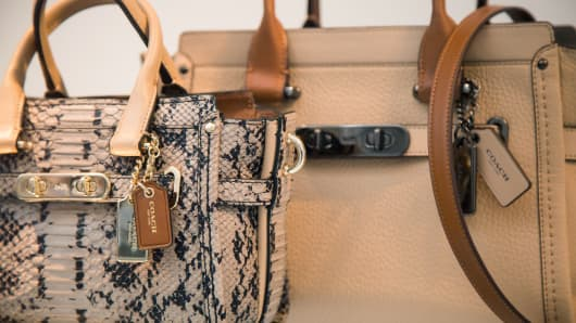 Handbags are displayed in the window of a Coach Inc. store in New York.