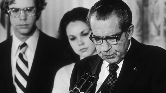 9th August 1974: U.S. President Richard Nixon looks down as stands at a podium, reading a farewell speech to his staff following his resignation, the White House, Washington, D.C.