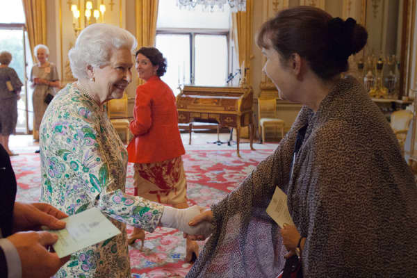 Julie Deane meeting the Queen of England