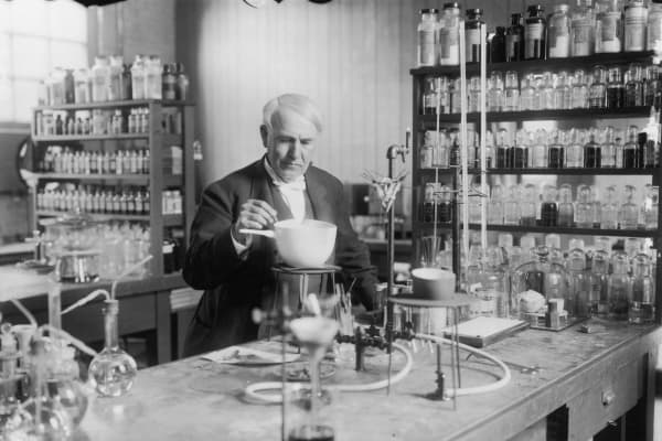 American inventor Thomas Edison (1847 - 1931) conducting an experiment in his laboratory, circa 1910.