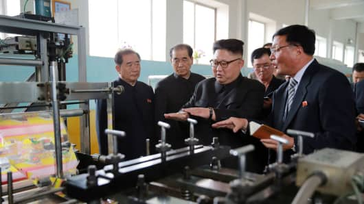 This undated picture released from North Korea's Korean Central News Agency (KCNA) on May 10, 2017 shows North Korean leader Kim Jong-Un (C) visiting the Rangnang Disabled Soldiers' Essential Plastic Goods Factory in Pyongyang.