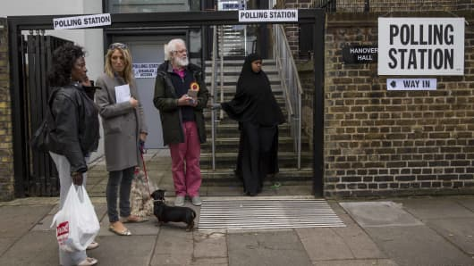 A woman leaves a General Election polling station in the London Borough of Islington on May 7, 2015.