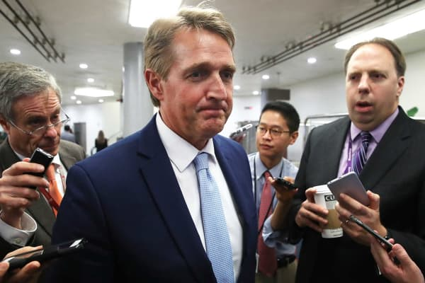 Sen. Jeff Flake (R-AZ) speaks to reporters about President Trump's firing of FBI Director James Comey, on Capitol Hill May 10, 2017 in Washington, DC.