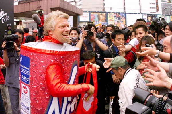 Richard Branson handing out Virgin Colas in Japan in 1999.