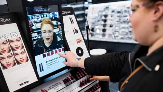 Melissa Feliciano tries out the Sephora Virtual Artist at Sephora's flagship store in New York, March 31, 2017.