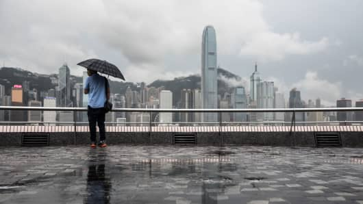 A man stands before the city skyline in Hong Kong on May 4, 2017.