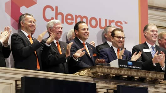 Chemours non-executive Chairman Richard Brown, second left, applauds as CEO Mark Vergano, third left, rings the New York Stock Exchange opening bell, Monday, June 29, 2015. Chemours' spin-off from DuPont is expected to begin trading on July 1.