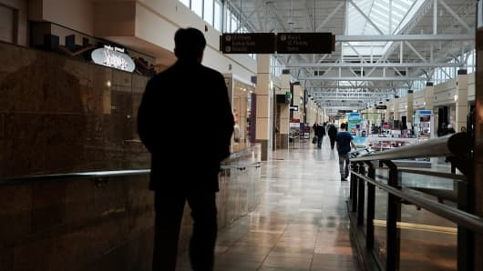A man walks through a nearly empty shopping mall on March 28, 2017 in Milford, Connecticut. As consumers buying habits change and more people prefer to spend money on technology and experiences like vacations over apparel, shopping malls across the country
