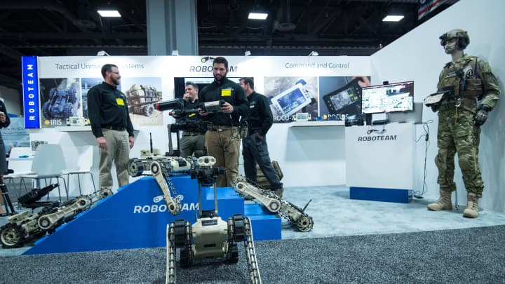 A man demonstrates the use of a robot by Roboteam during the Association of the United States Army (AUSA) Annual Meeting and Exposition in Washington,DC on October 14, 2014.