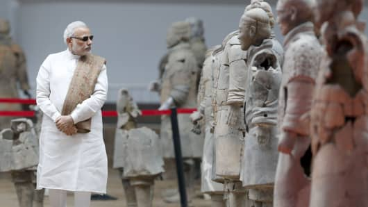 Xi'an, China - May 14 2015: India Prime Minister Narendra Modi visits Emper Qins Terra - cotta Warriors and Horses Museum on May 14, 2015 in Xi'an, Shaanxi province.