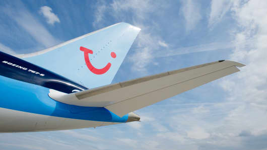 Picture taken on June 12, 2013 shows a Boeing 787 'Dreamliner' plane of Thomson Airways with the logo of tourism giant TUI at the Hanover airport in Langenhagen, central Germany.