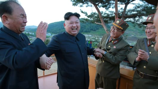 North Korean leader Kim Jong Un reacts with Ri Pyong Chol (L), in this undated photo released by North Korea's Korean Central News Agency (KCNA) on May 15, 2017.