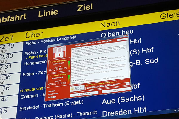 A window announcing the encryption of data including a requirement to pay appears on an electronic timetable display at the railway station in Chemnitz, eastern Germany, on May 12, 2017. A fast-moving wave of cyberattacks swept the globe, apparently exploiting a flaw exposed in documents leaked from the US National Security Agency.