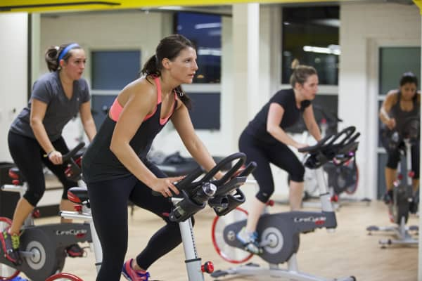 Women take a spin class in Baltimore, Maryland.