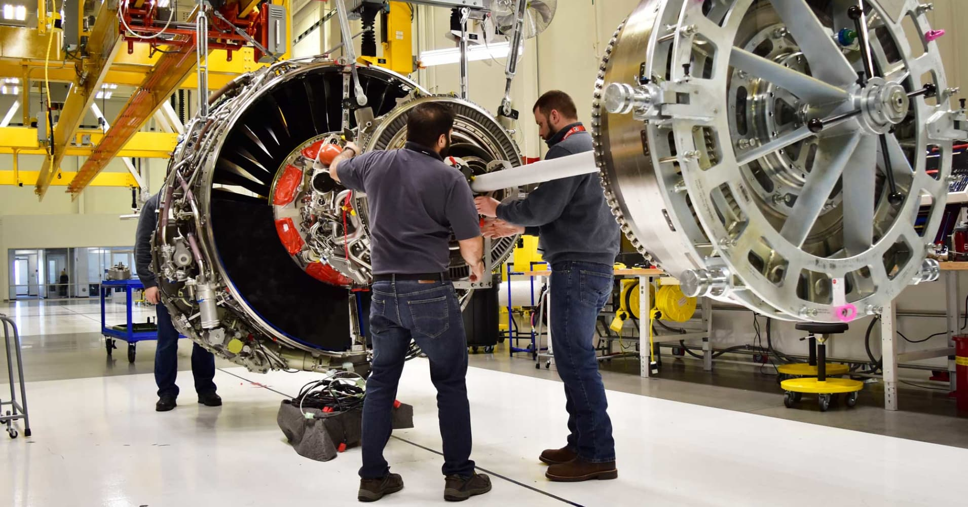Technicians build LEAP engines for jetliners at a new, highly automated General Electric (GE) factory.