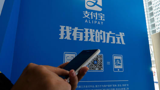A customer uses the Alipay payments app on a smartphone.