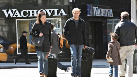 People walk near a Wachovia bank branch in New York, in 2008.