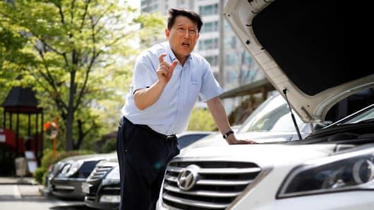 Kim Gwang-ho speaks as he checks his Hyundai Motors car during an interview with Reuters in Yongin, South Korea, April 19, 2017.