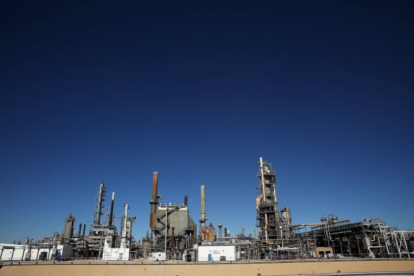 An oil refinery is situated along a highway in Big Spring, Texas.