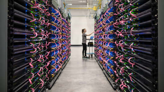 An person monitors servers using Google's second-generation tensor processing unit (TPU.