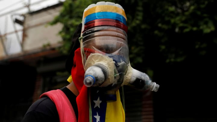 A demonstrator wears a homemade gas mask during rally against Venezuela's President Nicolas Maduro in Caracas, Venezuela May 1, 2017.