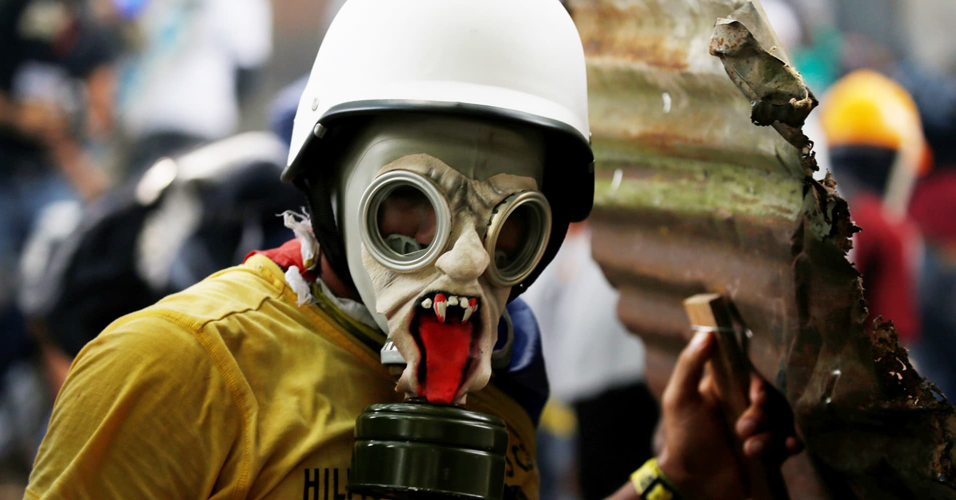 A demonstrator wears a gas mask during a rally against Venezuela's President Nicolas Maduro in Caracas, Venezuela May 1, 2017.