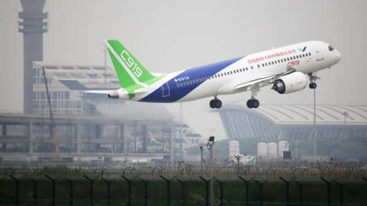 A C919 passenger jet takes off from Pudong International Airport for its maiden flight, on May 5, 2017 in Shanghai, China.
