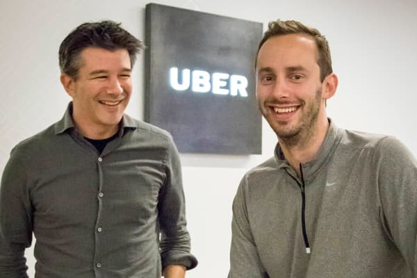 Uber CEO Travis Kalanick, left, and Anthony Levandowski, co-founder of Otto, pose for a photo in the lobby of Uber headquarters, Thursday, Aug. 18, 2016, in San Francisco.