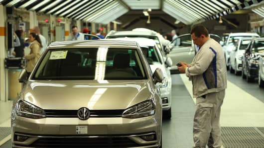 An employee performs the final inspection of a Golf 7 automobile at the Volkswagen in Wolfsburg, Germany.